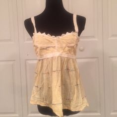 Free people tank top Fun and flowy light weight tank with adjustable tied back. Can be worn with something underneath or have partial back revealed when tied shut. Fun, flirty, and chic! By New Romantics Free People Tops Tank Tops