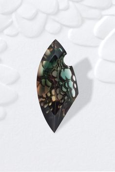 "AGTA, Spectrum Award Winners, 2012, Honorable Mention, Innovative Faceting  Darryl Alexander, Sunstone Butte Mining Co., Gilbert, AZ  ""Sea Foam and Sunset"" 70.0 ct. bubble-cut Sunstone."