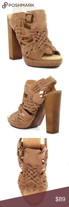 """Wooden Woven Leather Platform Sizing: True to size. - Open toe - Leather vamp construction - Woven detail - Slip-on - Lightly padded footbed - Platform heel - Approx. 5.25"""" heel, 1"""" platform - Imported Materials: Leather upper, rubber sole naughty monkey Shoes Platforms"""