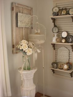 love the shutter shelf with cast iron brackets
