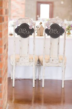 Love these tall back antique finish Mr & Mrs chairs | Lavender Infused Romantic Olde Dobbin Station Texas Wedding | Photograph by The Freckled Key  http://storyboardwedding.com/lavender-romantic-olde-dobbin-station-texas-wedding/