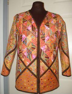 http://www.moonlightdesignquilts.com/shop/Quilted-Sweatshirt-Patterns.htm