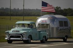 Ken and Petey, arriving in their 1955 GMC truck and 1964 Airstream Bambi II.  Looks just right with the american flag!