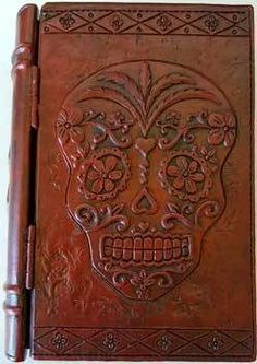 "4"" x 6"" Day of the Dead book box A nifty little brown colored, solid book box. Having an embossed detailed Day of the Dead Skull, on it's front hinged cover, with handsome embossed scrolling on it's spine cover. Safe keep your tarot cards or hide your trinkets and treasures within. The depth of the inside compartment measures 1 1/4"". Made of resin.  https://shadowsofthemoon.net   #witchy #altar #ilovemywitchyways #Pagan #Book #shadowsofthemoon #witchcraft #Wiccan #Wicca"