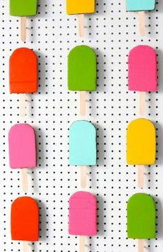 Cool DIY backdrop: Ice pops crafted from cardboard and pegboard!