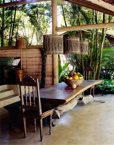 dining table made with cashew-tree trunk as base in social area photo by Fernando Lombardi