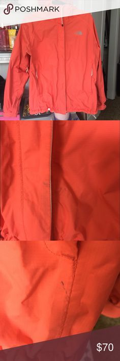 Peach North Face Windbreaker This is a size large and has drawstrings to cinch in the hem of the jacket & the hood. It's been worn a decent amount of times and has a few minor stains as shown in the picture, but it has so much life left in it! It is such a unique color and is a great, weightless layering option. North Face Jackets & Coats