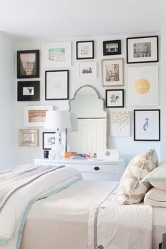 Gallery wall around dresser mirror