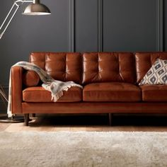 """Darrin 89"""" Leather Sofa with tufted cushions and mid century modern sleek look on sale for $2000"""