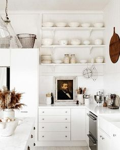 Love the open shelves, pops of dark wood and the portrait