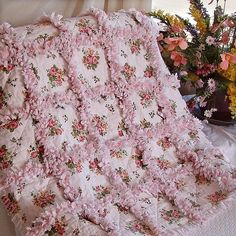 This pretty rag quilt is actually meant for a nursery, but it would be great in any room.
