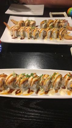 Torched Dragon- Shrimp with crab roll topped with white fish torched to perfection! Spicy Mayo and eel sauce too, ofcourse.  Found here (+=+) More Yummy Sushi