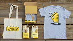 Check out this cartoon-inspired promotional packaging for Studio Garbeo. Designed by Fátima de Juan, a cardboard box, screen printed with an illustrated hand, houses a pair of tote bags, notebooks, stickers, tags, and a t-shirt color coordinated in yellow.