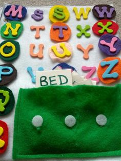 Close up of ABC & spelling quiet book pages from And Next Comes L