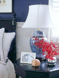 blue and white lamps are stunning here, pop of red flower is beautiful, silver frames