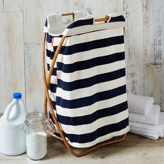 This Bamboo Laundry Single Hamper is made from rapidly-renewable bamboo and cotton canvas fabric. Stash in a bedroom corner or bathroom; with stylish hammam stripes, it's too cute to hide in a closet.