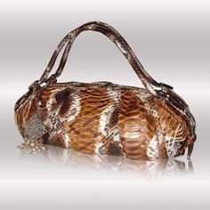 Luxury handbags made in Italy from python, alligator and crocodile skins, GLENI brand: see http://www.italianmoda.com/storefronts/gleni/