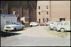 231739PD: Library staff car park, Francis Street, Perth, ca. 1965   https://encore.slwa.wa.gov.au/iii/encore/record/C__Rb3430672