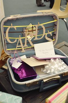 Cute idea to collect cards at the reception!!  Find a vintage suitcase & decorate it!!