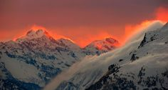 Sunset illuminates the peaks of the mountains near the Swiss mountain resort of St. Moritz, Switzerland.  © ARND WIEGMANN/Newscom/Reuters