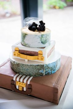 travel themed cake with camera toppers  http://www.weddingchicks.com/2013/11/14/pink-and-purple-wedding/