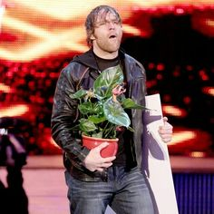 Dean Ambrose and his sidekick Mitch the potted plant