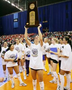 Washington's Christal Morrison holds up the championship trophy after winning the NCAA Division I Women's Volleyball Championship match between the...