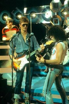David Bowie plays with T. Rex & Marc Bolan on Marc's TV Programme  Note: Marc's arse Is falling out of his trousers...