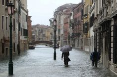 Venice with the Acqua Alta - High Water How you can see the venetian have no problem to go out even if there is water on the street. Just bring with you some boots. http://venicegondola.com