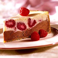 Two cheesecake layers--one raspberry, one chocolate--stack up to make one stunning dessert.