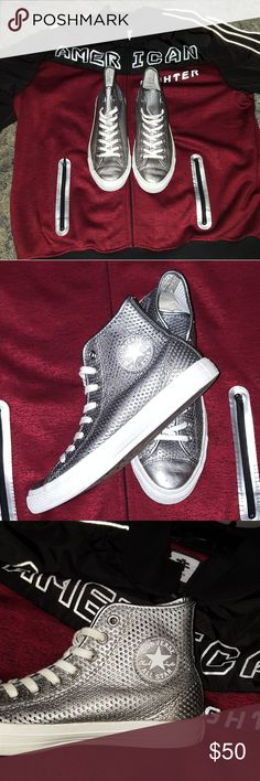Chuck Taylors silver leather perforate Chucks  The size shows 7.5, wo 9.5. I tried them on.  they're a perfect snug men's 8.5 fit.  they were mis-tagged Converse Shoes Sneakers