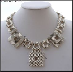 Loving this geometrical necklace. The beading is so precise and perfect.