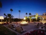 Surrounded by palm trees, this glamorous open terrace at  AKA Beverly Hills  has the feel of a tropical resort but is actually within close walking distance of L.A.'s Golden Triangle, famous for its world class boutiques along Rodeo Drive and Robertson Boulevard. Raised plant beds, a fire pit and lush border landscaping add extra allure to this space which offers spectacular views of the Hollywood Hills.