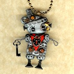 Steampunk Robot Wizard of Oz Tinman Necklace Pin/Brooch Polymer Clay Figurine. $25.00, via Etsy.