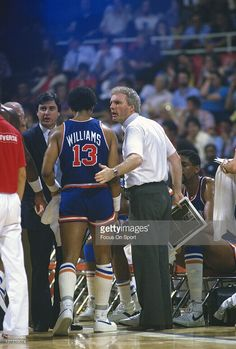 Head coach Hubie Brown of the New York Knicks talks with his player Ray Williams #13 during an NBA basketball game circa 1984. Brown coached the Knicks from 1982-87.
