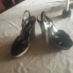 Black and gold 4 inch Steve Madden wedged sandals Worn once black suede leather upper with gold. One small flaw not noticeable when worn see pic. One stitch missing but doesn't affect shoe when worn. Steve Madden Shoes Wedges