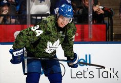 Auston Matthews of the Toronto Maple Leafs wears a camoflage jersey during warm up at the Air Canada Centre on January 21 2017 in Toronto Ontario. Hockey Baby, Hockey Girls, Ice Hockey, Boys, Baseball Scores, Baseball Training, Baseball Tickets, Backyard Baseball, Maple Leafs Hockey