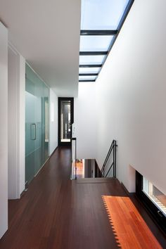 A row of skylights over the stairwell.  Dansanli House / ADF Architects
