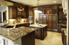Dark Wood Cabinets with Light/Dark Brown Marbled Counter-top Finish