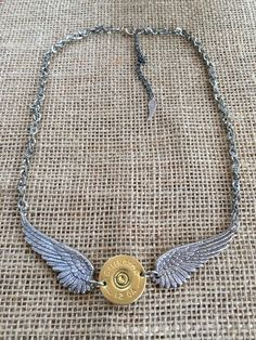 12 Gauge Shotgun Shell and Wings Necklace by ShotThruTheHeart on Etsy