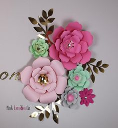 "My current processing time is 3 weeks nursery wall decal Set of 13 paper flowers 1 extra large 16"" flower 4 Large flowers are 12 x 12 8 Small Flowers 5x5 6 leaves Option to include 18"" gold vinyl name(Please leave name in notes during checkout) size may vary depending on length of name"