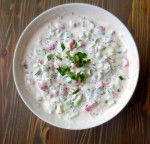 iRaita is a thick yogurt-based dip. It is usually made with a pile of chopped fresh vegetables – like cucumber, onion, and tomato – and seasoned with traditional Indian spices and fresh herbs, such as mint, cilantro, or parsley.
