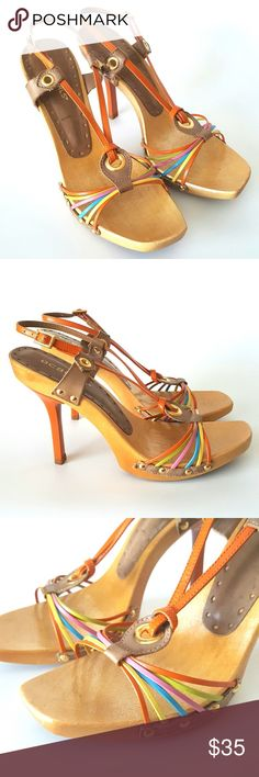 "BCBGirls Strappy Wooden Multicolor Leather Sandles BCBGirls Strappy Wooden Multicolor Leather Sandles. Leather Upper. Made in Brazil. Marked 7B. Wooden platform construction. Orange acrylic 4 1/2"" heel. Very good to excellent pre-owned condition. Please review all photographs as a part of the description. BCBGirls Shoes Sandals"