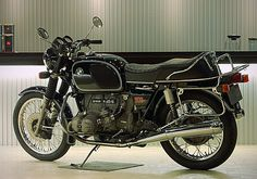 "This immaculate example of the Hans Muth-designed BMW R90/6 was recently sold in Tokyo by Ritmo Sereno (""Serene Pace""). The upscale workshop has the glacial cool of a Porsche showroom, but specialises in mint BMWs and Moto Guzzis from the 70s to the 90s. The stock list is always worth checking, along with the portfolio…"