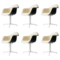 Four Plastic DAL Armchairs by Eames for Miller | From a unique collection of antique and modern armchairs at https://www.1stdibs.com/furniture/seating/armchairs/