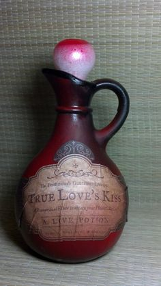 "Creepy ""True Love's Kiss"" recycled glass bottle turned potion vessel for your Halloween decor. Label reads, ""To obtain your Hearts Desire""."