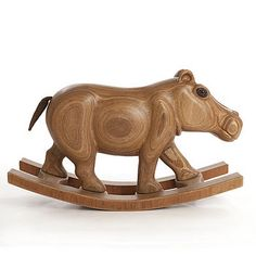 What kid could be lucky enough to have one of these insanely cool Wooden Rocking Hippos - handmade in the UK. Wow, I want one for myself!