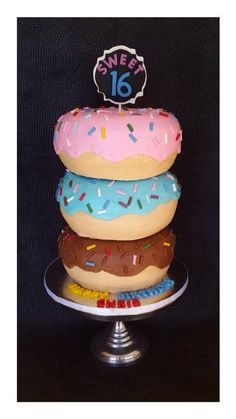 "Triple Donut Cake covered in buttercream. Total height 12"", width 8"". Jumbo donut. Giant donut. Sweet sixteen. Sprinkle donut."