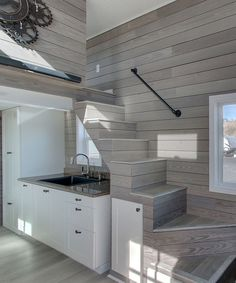 Zilker by ATX Tiny Casas - Tiny Living The tiny home comes fully furnished, including a sectional sofa that converts to a queen size bed. Also in the living area is a 42 LED TV that lowers down out of sight when not in use. Tiny House Loft, Best Tiny House, Building A Tiny House, Modern Tiny House, Tiny House Living, Tiny House Plans, Tiny House Design, Tiny House On Wheels, Tiny House Movement