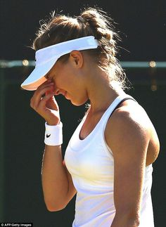 Controversy: Eugenie Bouchard faced criticism when her black bra slipped out from under he...
